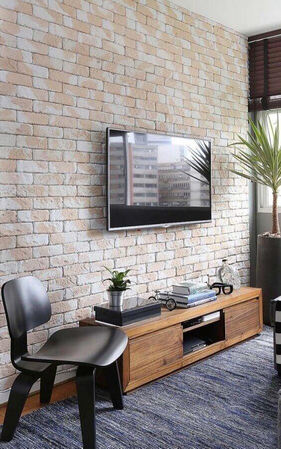 rack pequeno para sala com parede de tijolinho Foto Otimizi