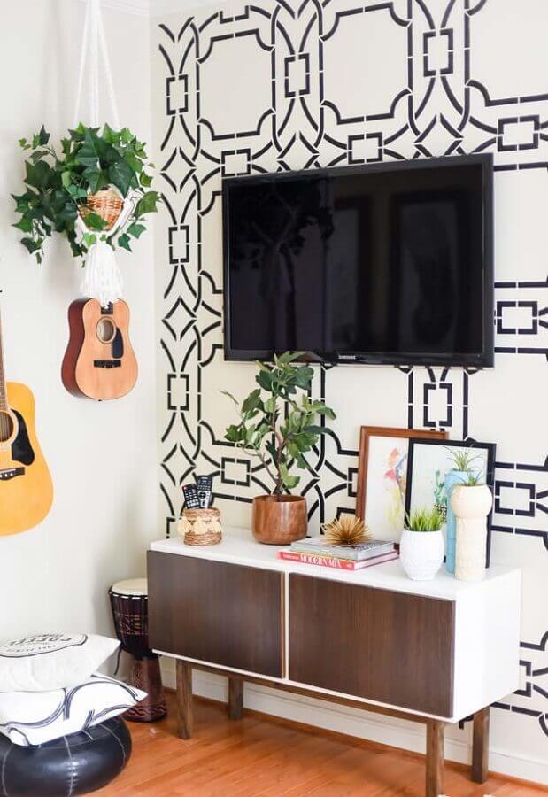rack pequeno para sala decorada com papel de parede e violão Foto Pinterest