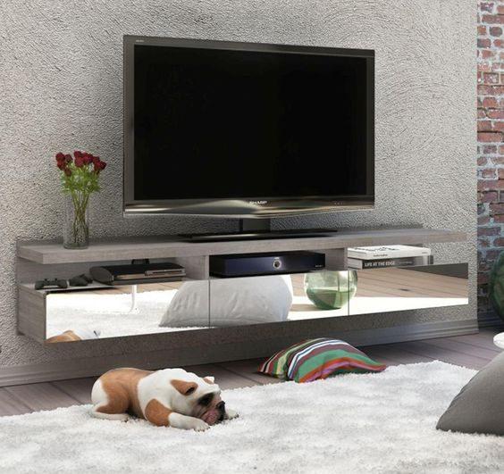 rack suspenso com gavetas espelhadas em sala de estar