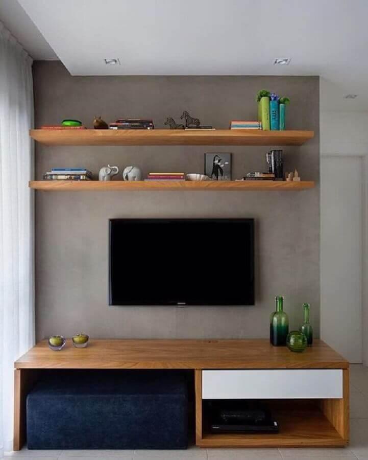 racks modernos para salas pequenas com parede de cimento queimado Foto Dcore Você
