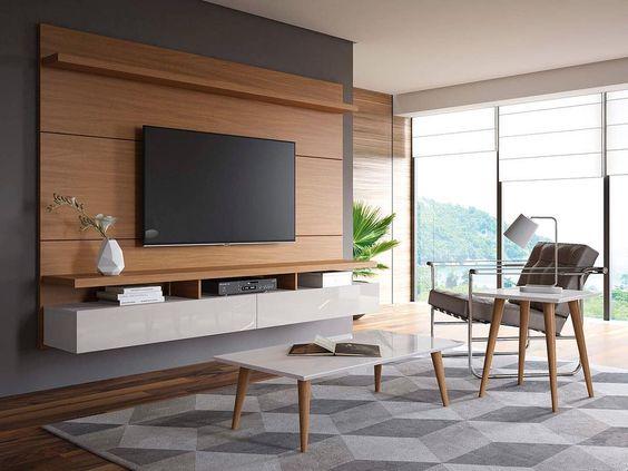 sala com tapete geométrico e rack suspenso moderno