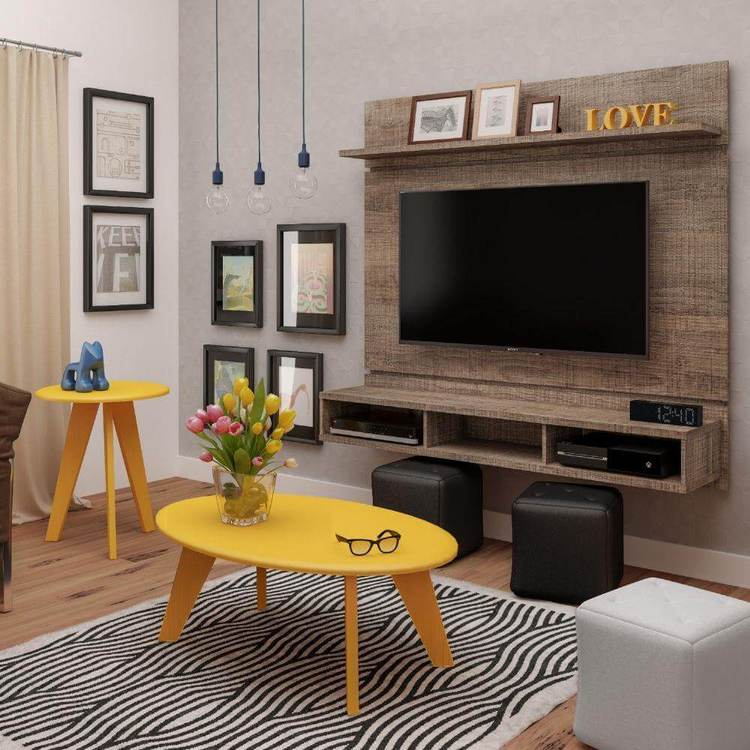 sala de estar com painel de tv e rack suspenso