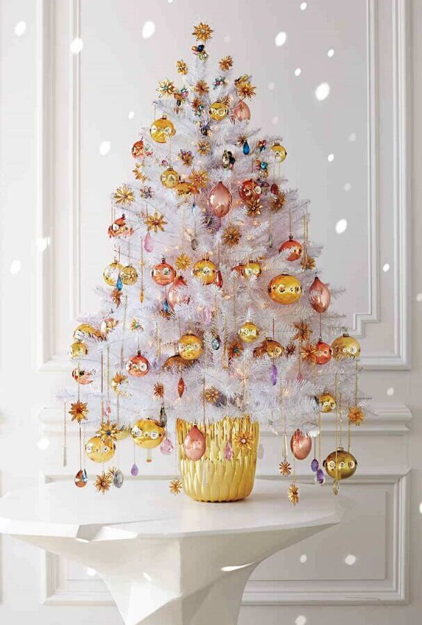 white Christmas tree decorated with gold and copper ornaments Photo Marth Stewart