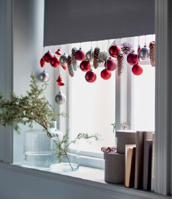 Christmas decorations fixed on the curtain of the environment