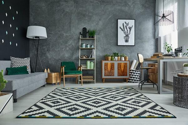 Sala de estar decorada com parede de cimento queimado. Fonte: Pinterest
