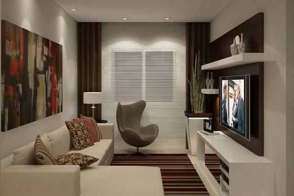 As poltronas para sala de tv podem ser posicionadas próxima a cortina do ambiente