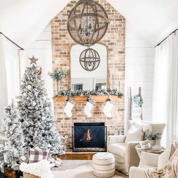 Depending on the space you can include two white Christmas trees in the environment