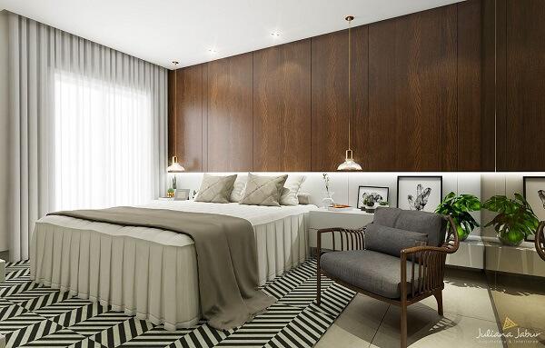 Quarto de casal com tapete moderno e poltrona cinza