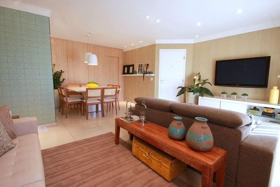 aparador de sofá - sala de estar com aparador e vaso verde