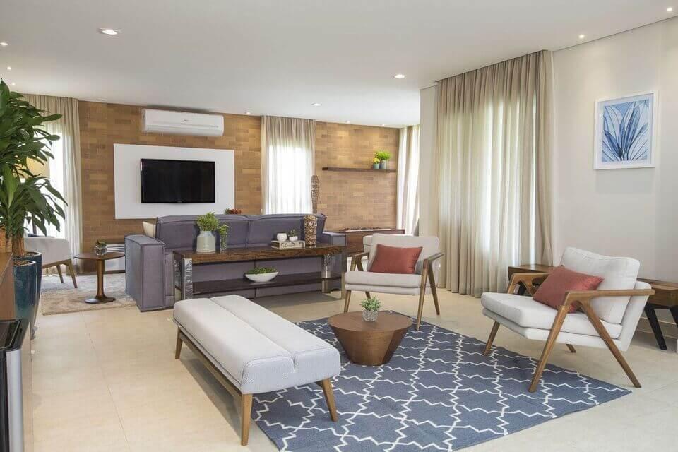 aparador de sofá - tapete com estampa moderna e almofadas vermelhas