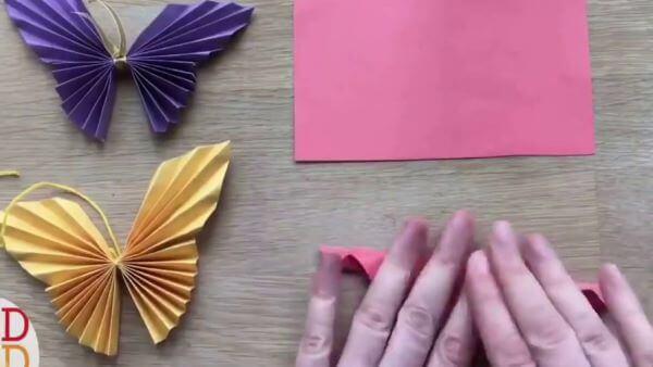 Aprenda como fazer borboletas de papel