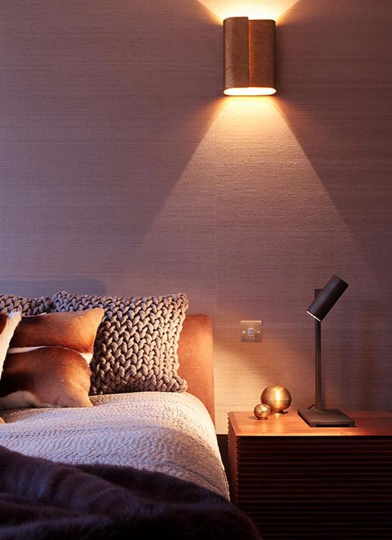 bedroom sconce - bedroom with yellow light sconce