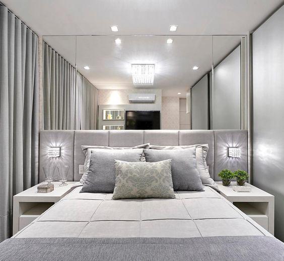 arandela para quarto - quarto em tons neutros com arandelas laterais