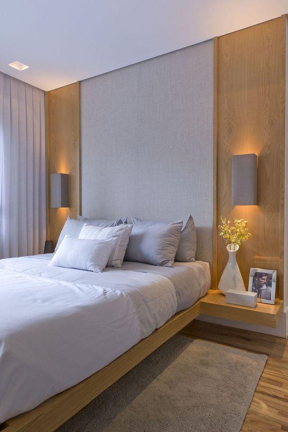 arandela para quarto - quarto com painel de padeira e arandela