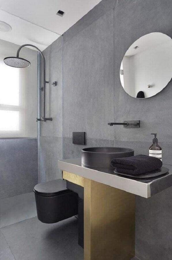 banheiro cinza decorado com espelho redondo e cuba preta Foto Pinterest