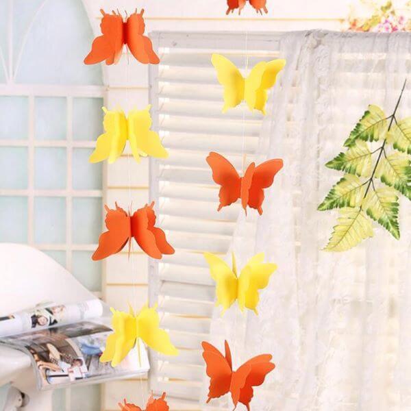 Borboleta de papel amarelo e laranja