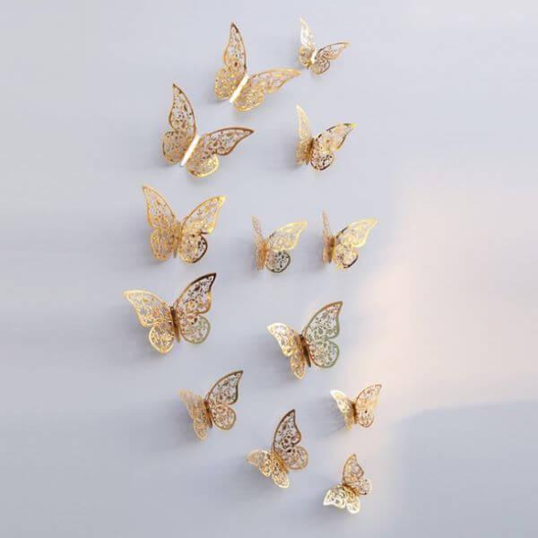 Borboletas de papel para decoração dourada