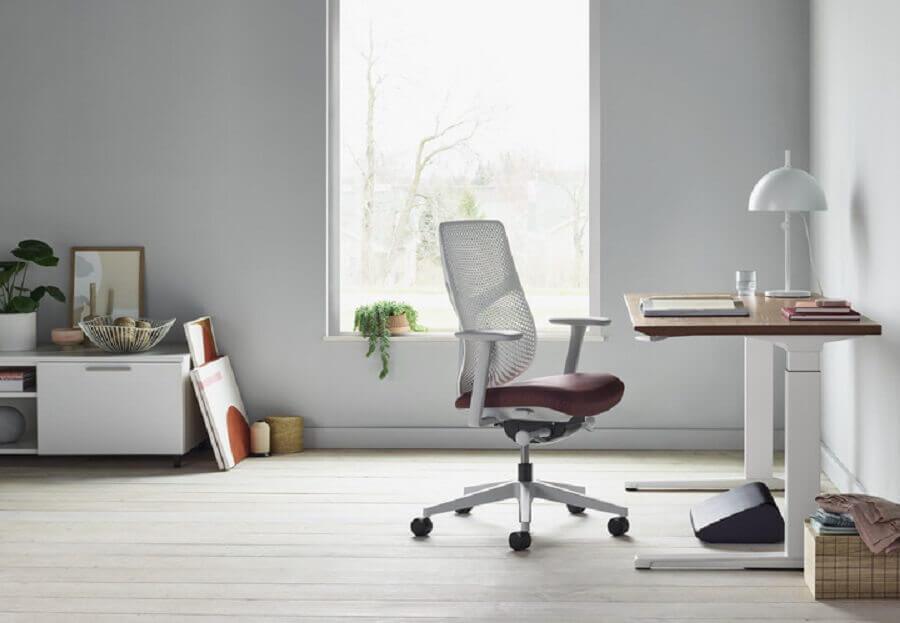 cadeira giratória branca com braço Foto Pinosy