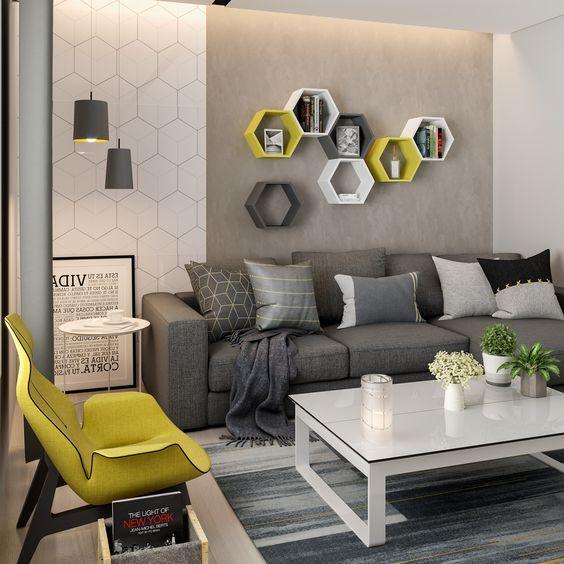 cor amarela - sala de estar com nichos e poltrona amarelas