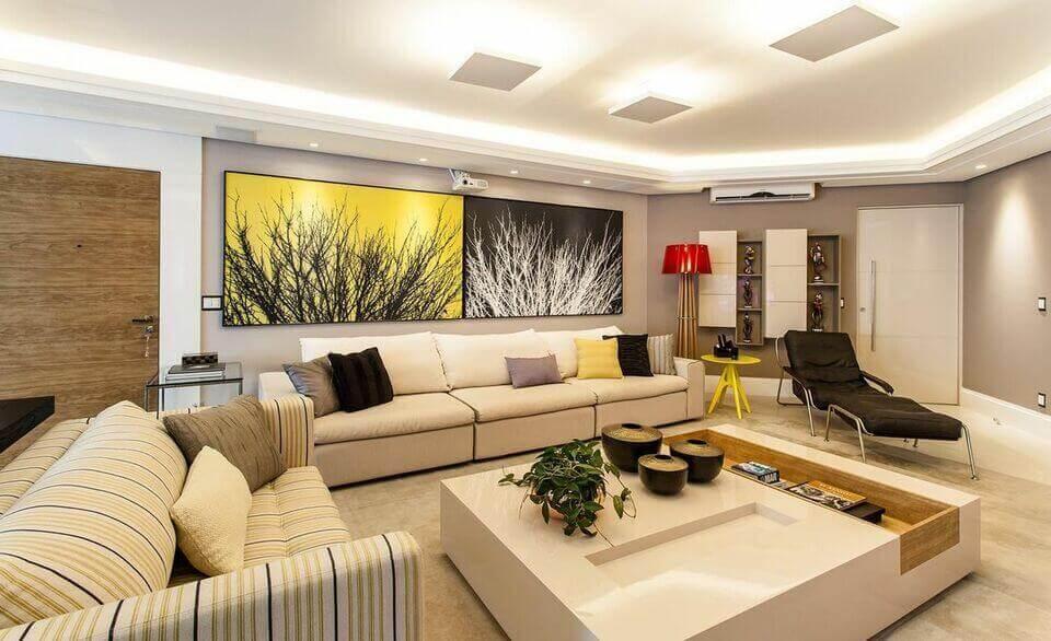 cor amarela - sala de estar com quadros amarelo e preto