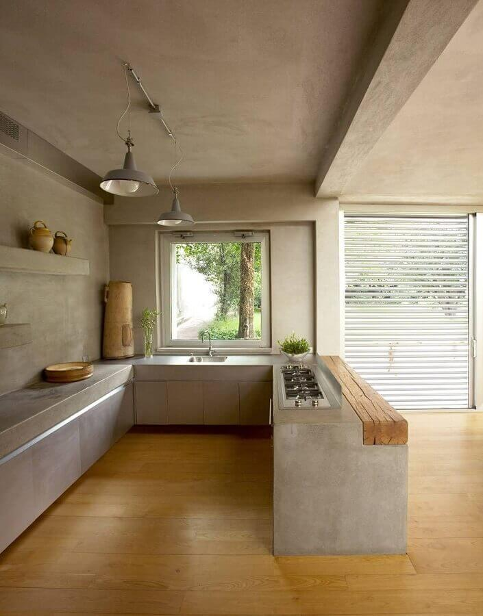 cozinha com bancada de concreto e cooktop Foto Zozu