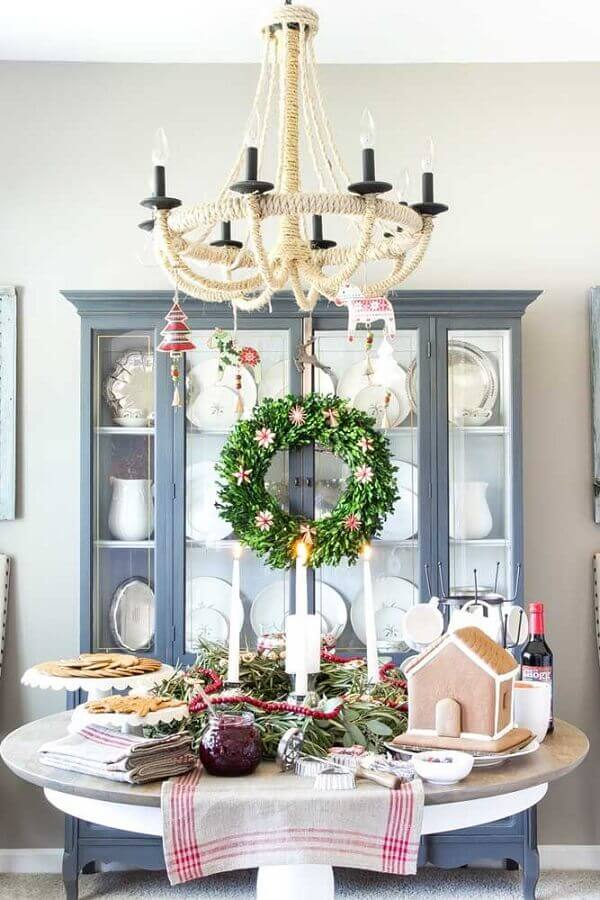 Christmas decoration with garland in crystal door Photo Apartment Therapy