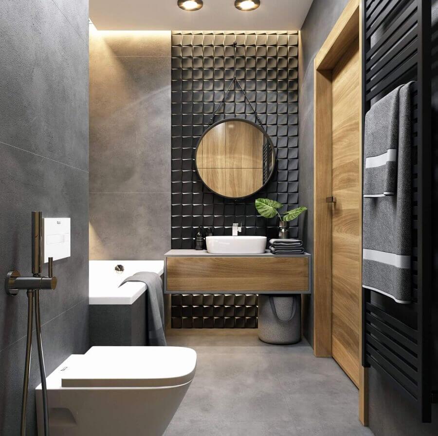 decoração moderna para banheiro preto e cinza com revestimento 3d e espelho redondo Foto JolyGram