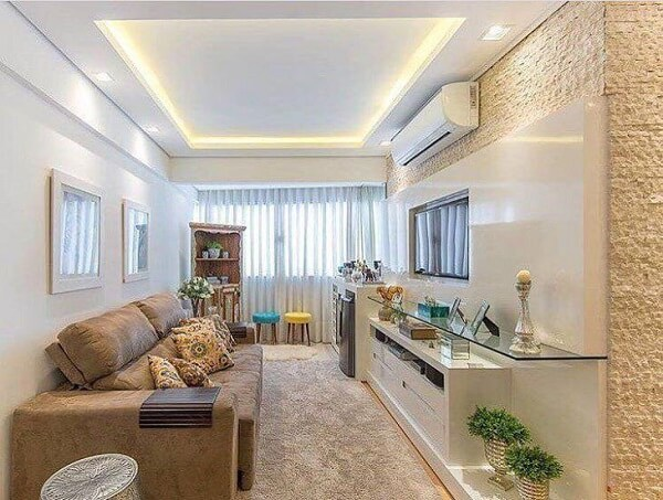 Sala de estar com sofá suede retrátil e reclinável