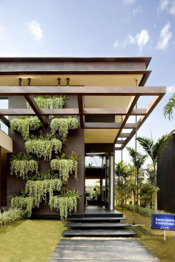 escada externa - fachada moderna com vegetação viva e pergolado