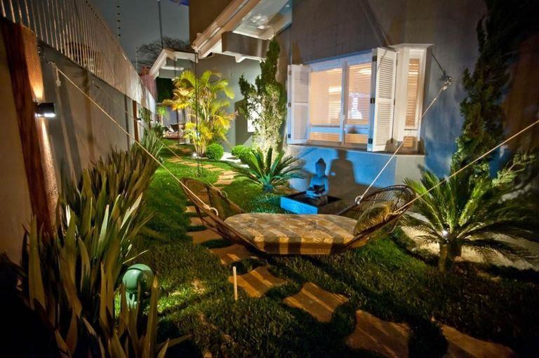 jardim residencial - jardim com cadeira de balanço