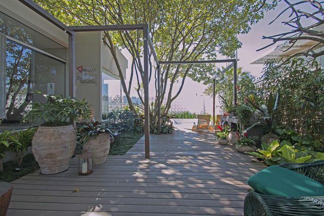 jardim residencial - jardim com vaso e porta vela