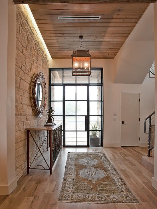parede de pedra - hall de entrada com parede de pedra