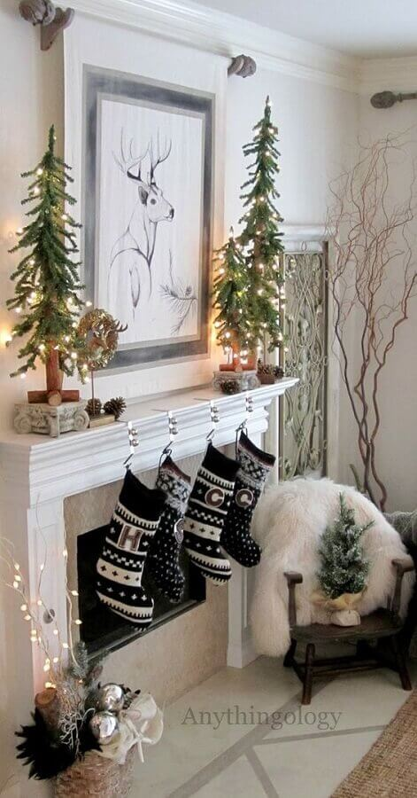 small pine trees and socks hanging from a fireplace for Christmas decoration for Homedit Photo Room