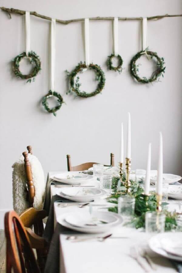 white dining room with simple Christmas decoration Photo Apartment Therapy