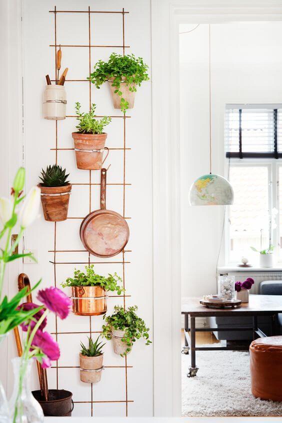 Suporte para vaso de plantas de ferro na decoração de casa