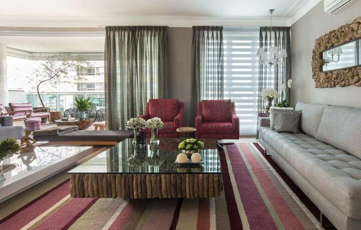 tapete colorido - sala de estar com poltrona vermelha e tapete