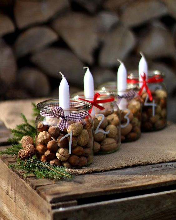 velas de natal - copos com velas e frutas secas