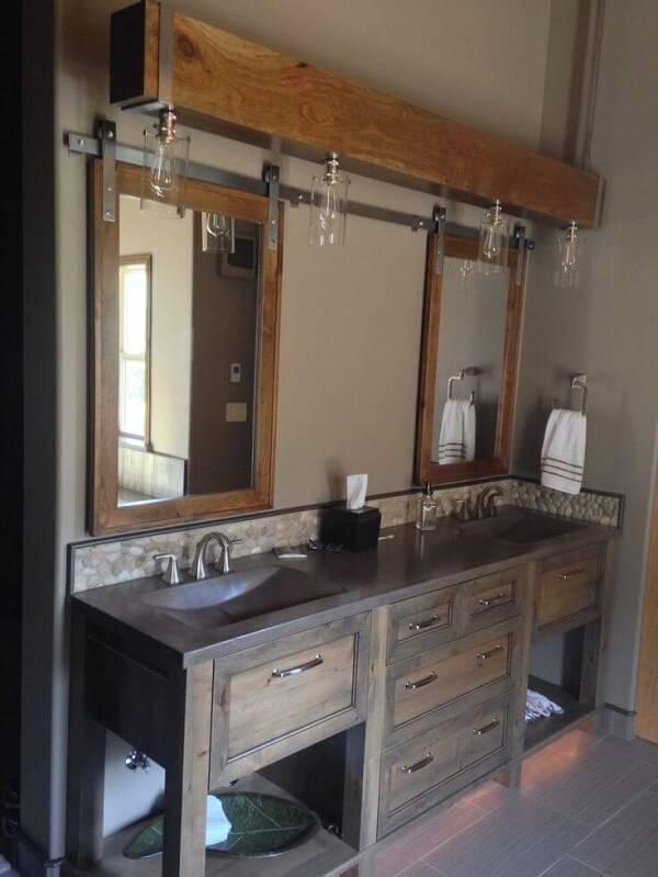 O armário de madeira para banheiro recebeu um acabamento especial com lampadas embutidas
