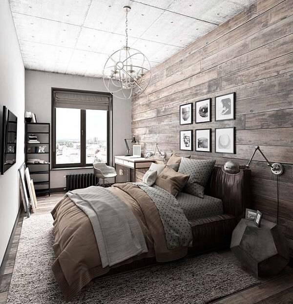 Quarto rústico com parede e piso de madeira