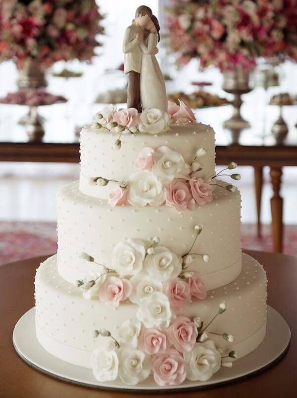 Fake wedding cake with a floral theme and grooms on top