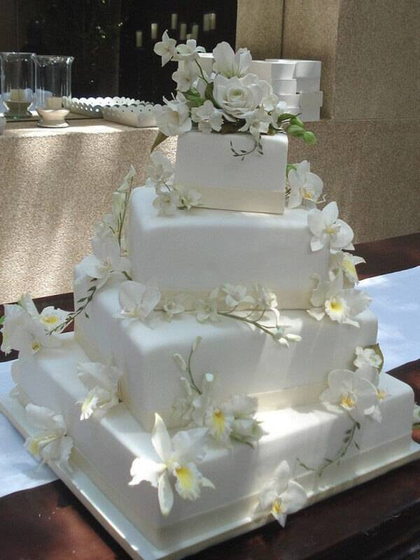Geometric fake cake with orchid flowers