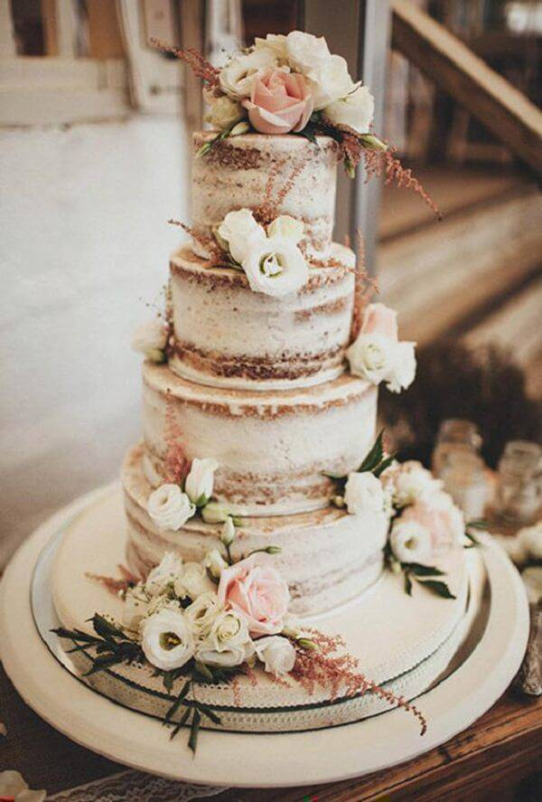 Rustic fake cake with natural flowers