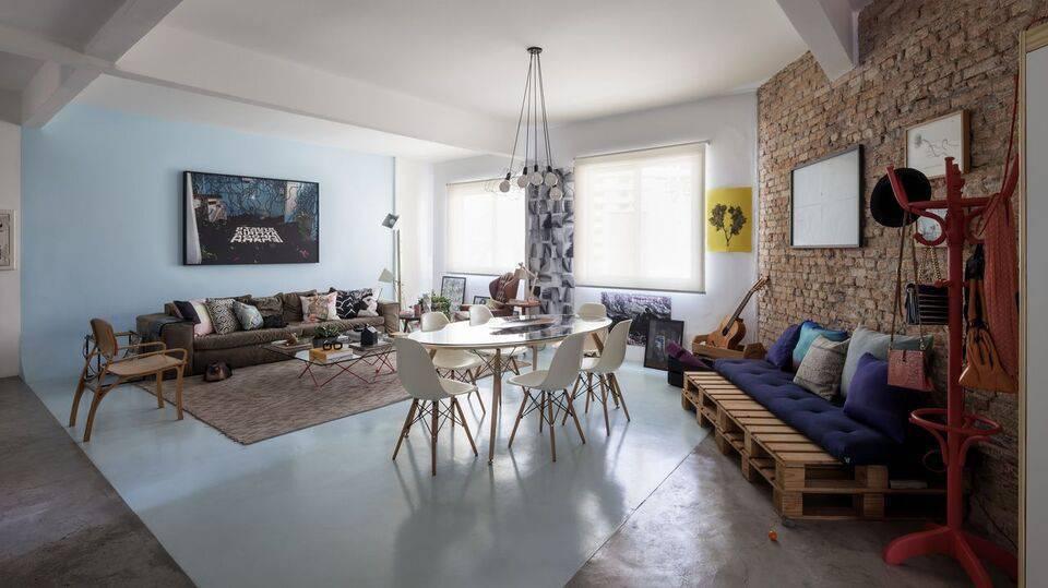 cadeira eames - parede de tijolinho no apartamento studio