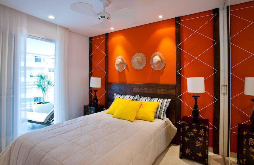 cor laranja - quarto de casal com a parede laranja