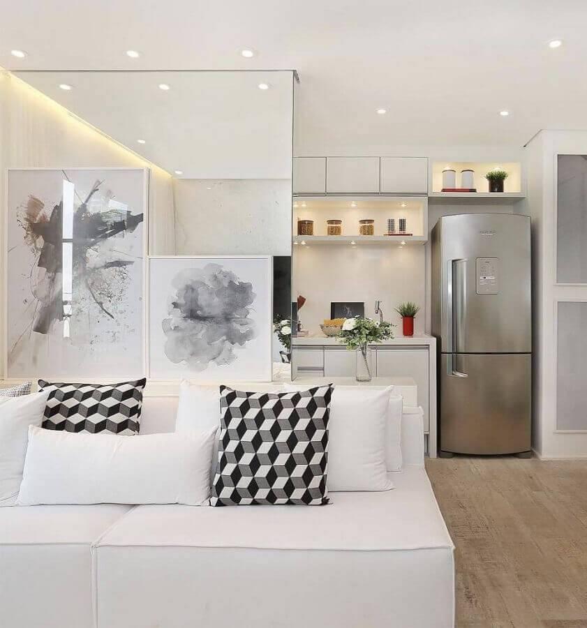 decoração clean com sofá pequeno sem braço branco Foto Reedecore