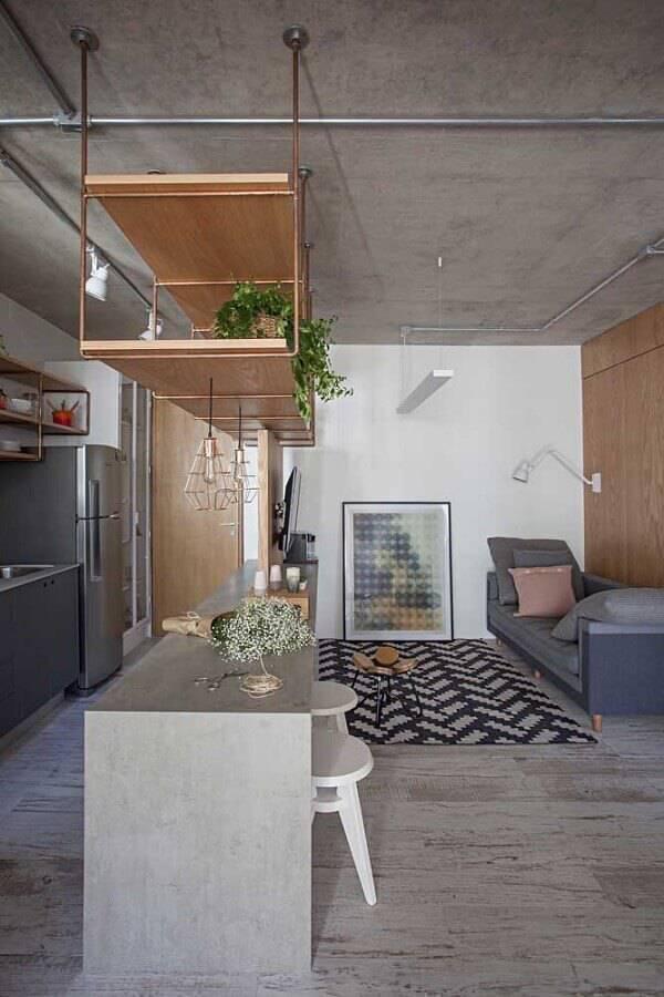 decoração contemporânea com cimento queimado para sala e cozinha conceito aberto Foto ArchDaily