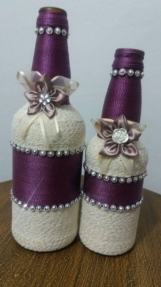 garrafas decoradas com barbante - garrafa com barbante roxo e branco com flores