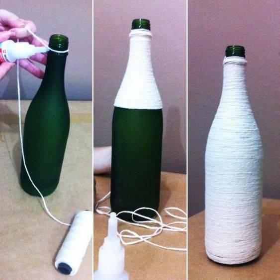 garrafas decoradas com barbante - garrafa sendo decorada