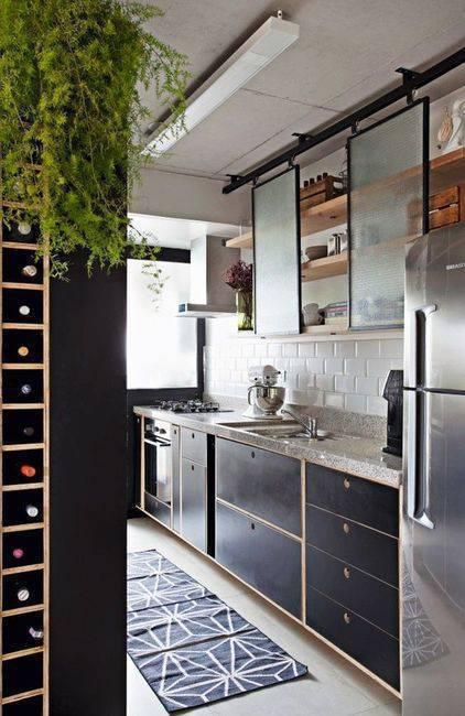 pia de granito - adega de madeira com vegetação e parede preta