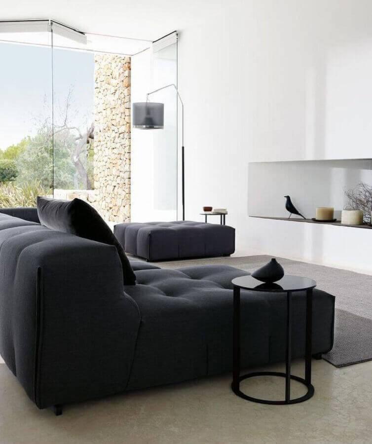 sala sofisticada decorada com sofá sem braço moderno Foto ArchiExpo